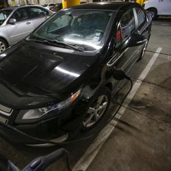 A Chevrolet Volt charges in the parking lot of the Salt Lake Main Library in Salt Lake City on Wednesday, Feb. 8, 2017. HB29, a legislative proposal to keep electric vehicle tax credits alive but phase them out entirely six years from now remains a work in progress, with negotiations continuing between its sponsor and other lawmakers.