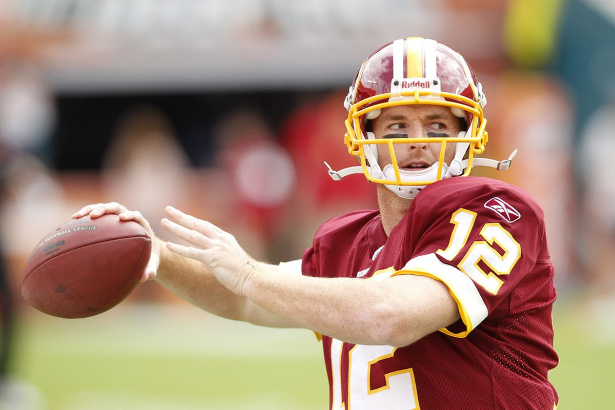 MIAMI, FL - NOVEMBER 13: John Beck #12 of the Washington Redskins warms up prior to the game against the Miami Dolphins on November 13, 2011 at Sun Life Stadium in Miami, Florida. (Photo by Joel Auerbach/Getty Images)
