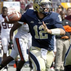 Pittsburgh quarterback Tino Sunseri (12) looks to pass in the third quarter against Virginia Tech in the third quarter of the NCAA football game, Saturday, Sept. 15, 2012 in Pittsburgh. Pittsburgh upset Virginia Tech 35-17.