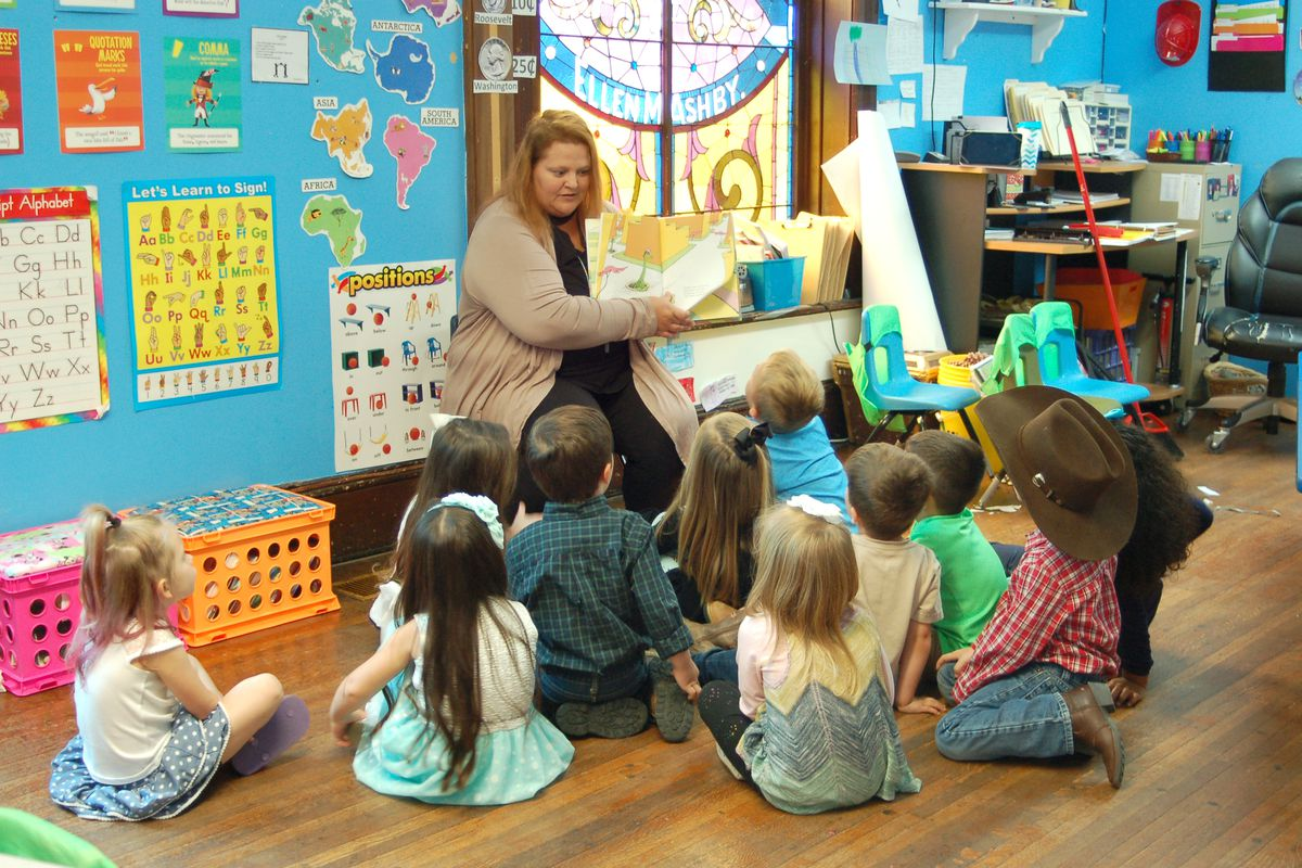A teacher reads to students at Fuzzy Bear Ministry Preschool and Daycare in Ladoga, Indiana.