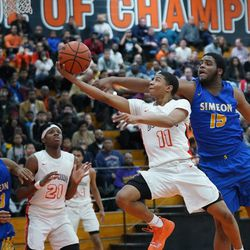 Young's Justin Warren (11) makes a shoot over Simeon's Jeremiah Stamps (15), Wednesday 02-13-19. Worsom Robinson/For Sun-Times