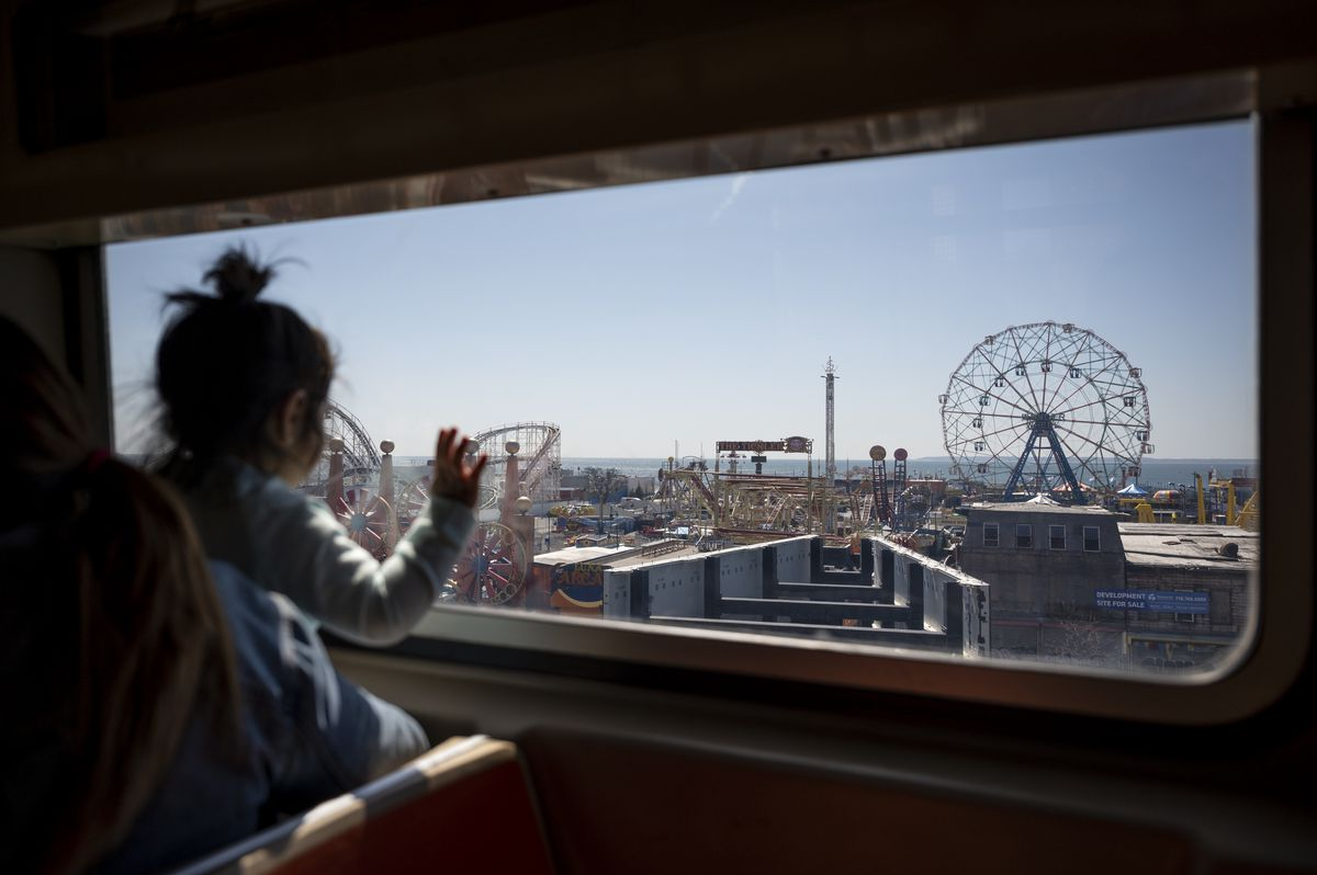 A child marvels at the Wonder Wheel and the rest of Coney Island as the Q train approaches the Stillwell Avenue station.