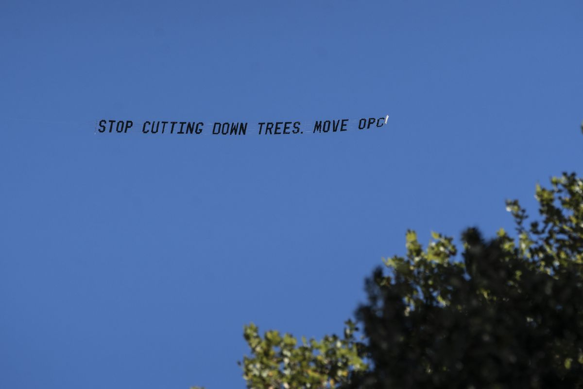 """A plane flying a banner that read """"Stop cutting down trees. Move OPC"""" flew over the site shortly before the Obamas took the stage for the official groundbreaking of the Obama Presidential Center in Jackson Park Sept. 28, 2021."""