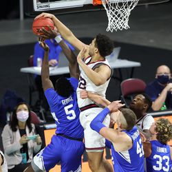 Gonzaga Bulldogs forward Anton Watson (22) blocks Brigham Young Cougars forward Gideon George (5) but is called for a foul as BYU and Gonzaga play in the finals of the West Coast Conference tournament at the Orleans Arena in Las Vegas on Tuesday, March 9, 2021. Gonzaga won 88-78.