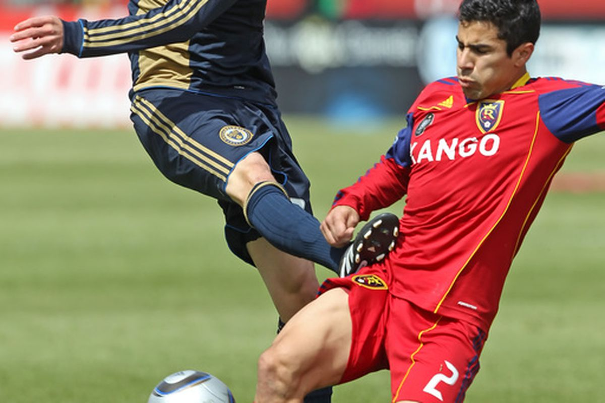SANDY, UT-MAY 8: Nick Zimmerman #23 of Philadelphia Union kicks Tony Beltran #2 of Real Salt Lake during the second half of an MLS soccer game in Rio Tinto Stadium May 8, 2010 in Sandy, Utah. (Photo by George Frey/Getty Images)