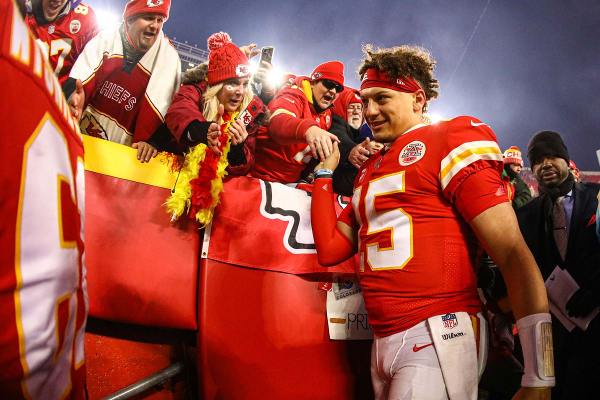 Kansas City Chiefs quarterback Patrick Mahomes celebrates with fans after defeating the Houston Texans in a AFC Divisional Round playoff football game at Arrowhead Stadium.
