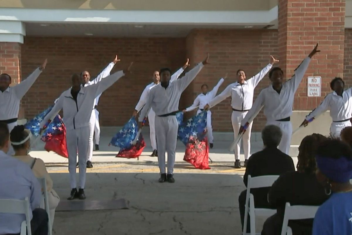 Members of the South Shore Drill Team performed at a ceremony Wednesday, July 28, 2021 to reopen the renovated Jewel-Osco at 94th Street and Ashland Ave. The store had been closed since it was looted during civil unrest last summer that followed the murder of George Floyd in Minneapolis.