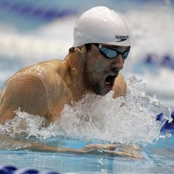 Michael Phelps swims the breaststroke leg in the men's 200-meter individual medley at the Indianapolis Grand Prix swimming meet in Indianapolis, Saturday, March 31, 2012. Phelps won with a time of 1:56.32.