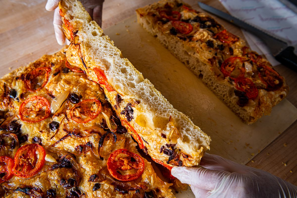 A cross-section of crunchy-on-the-outside focaccia with an airy interior