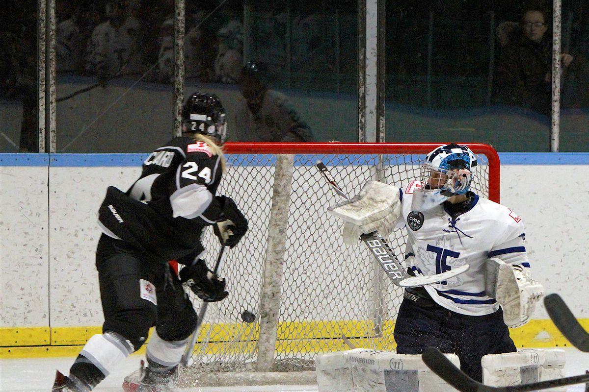 Courtney Birchard (24) of the Brampton Thunder scores on Toronto Furies goalie Christina Kessler (35) as their teammates look on during a Brampton home game in 2015-16