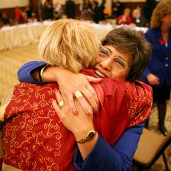 Democratic National Committee Vice-Chairwoman Linda Chavez-Thompson gets a hug from Aleita Huguenin at the DNC's Executive Committee meeting at the Montage Deer Valley in Park City on Saturday, Dec. 1, 2012.