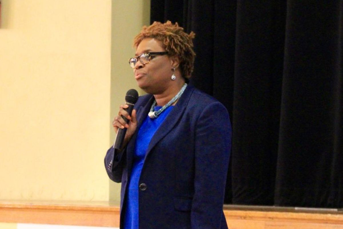 Yetta Lewis, co-founder and CEO of Gestalt Community Schools, answers questions from parents and teachers during an October 2016 assembly at Humes Preparatory Academy Middle School.