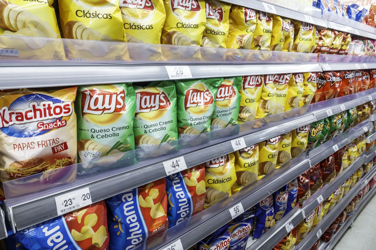 Shelves of potato chips for sale in Express.