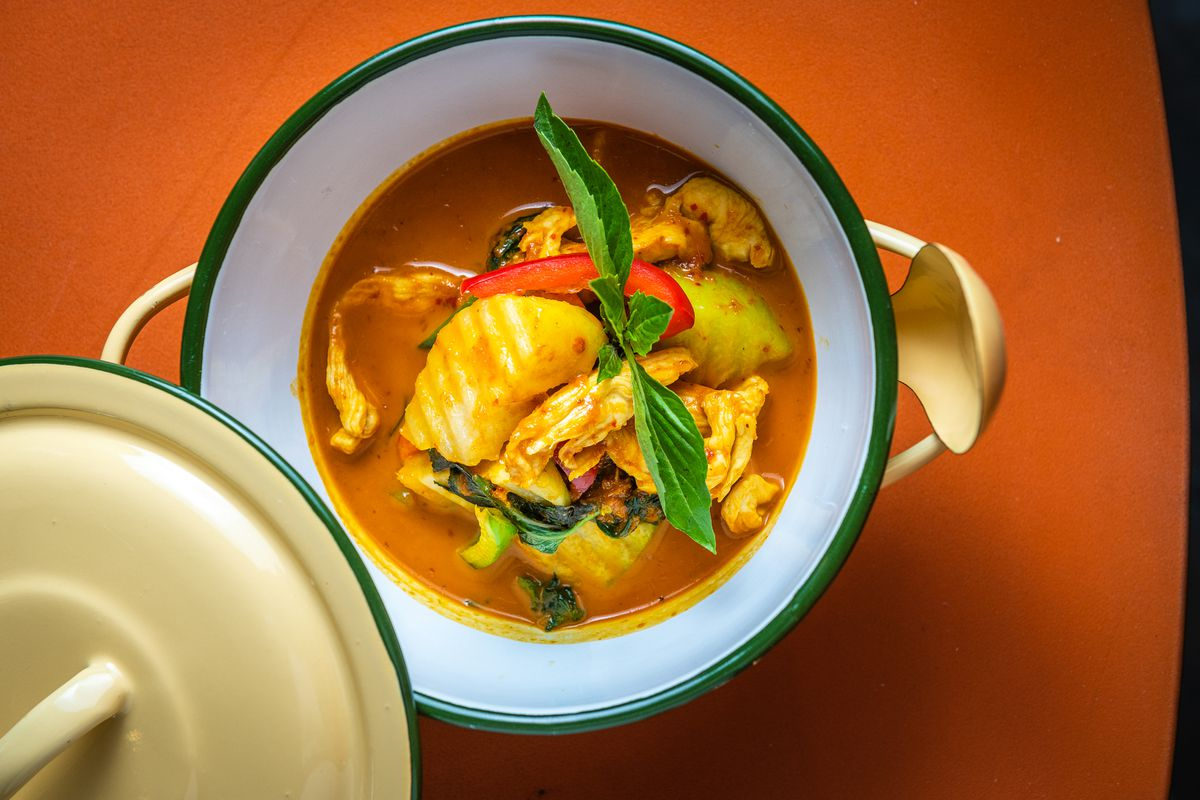 A red curry full of chicken, chayote squash, and Thai basil represents Central Thai cuisine