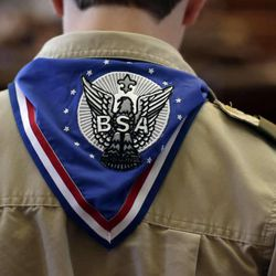 A Boy Scout wears an Eagle Scot neckerchief during the annual Boy Scouts Parade and Report to State in the House Chambers at the Texas State Capitol, Saturday, Feb. 2, 2013, in Austin, Texas. The executive committee of the Boy Scouts of America has unanimously approved a resolution that would end the organization's blanket ban on gay adult leaders and let individual scout units set their own policy on the long-divisive issue.