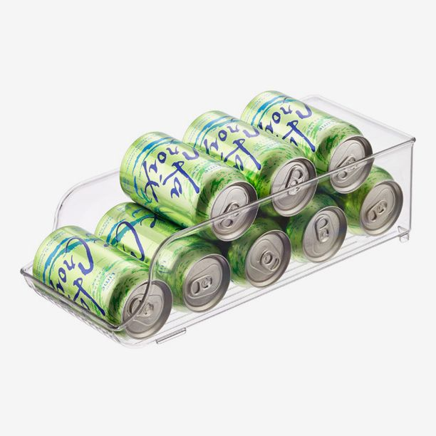 A clear storage bin containing eight cans of lime-flavored La Croix