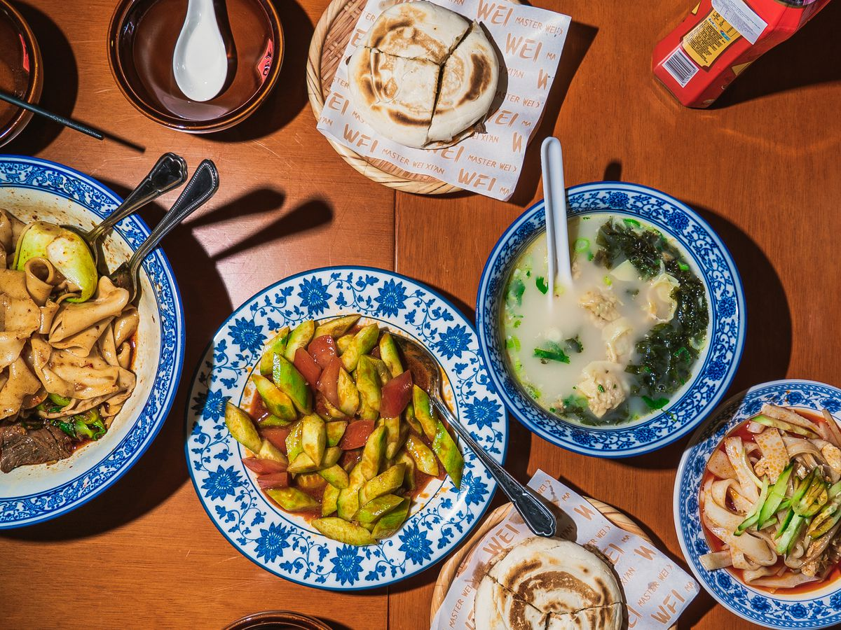 Biang biang noodles, smacked cucumbers, ou jia mo, and liang pi at Master Wei, Wei Guirong's outstanding Xi'an Chinese restaurant in Bloomsbury central London