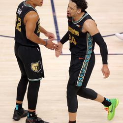 Memphis Grizzlies guard Desmond Bane (22) and Memphis Grizzlies forward Dillon Brooks (24) celebrate after Bane blocked a shot as the Utah Jazz and the Memphis Grizzlies play in game one of their NBA playoff series at Vivint Arena in Salt Lake City on Sunday, May 23, 2021.