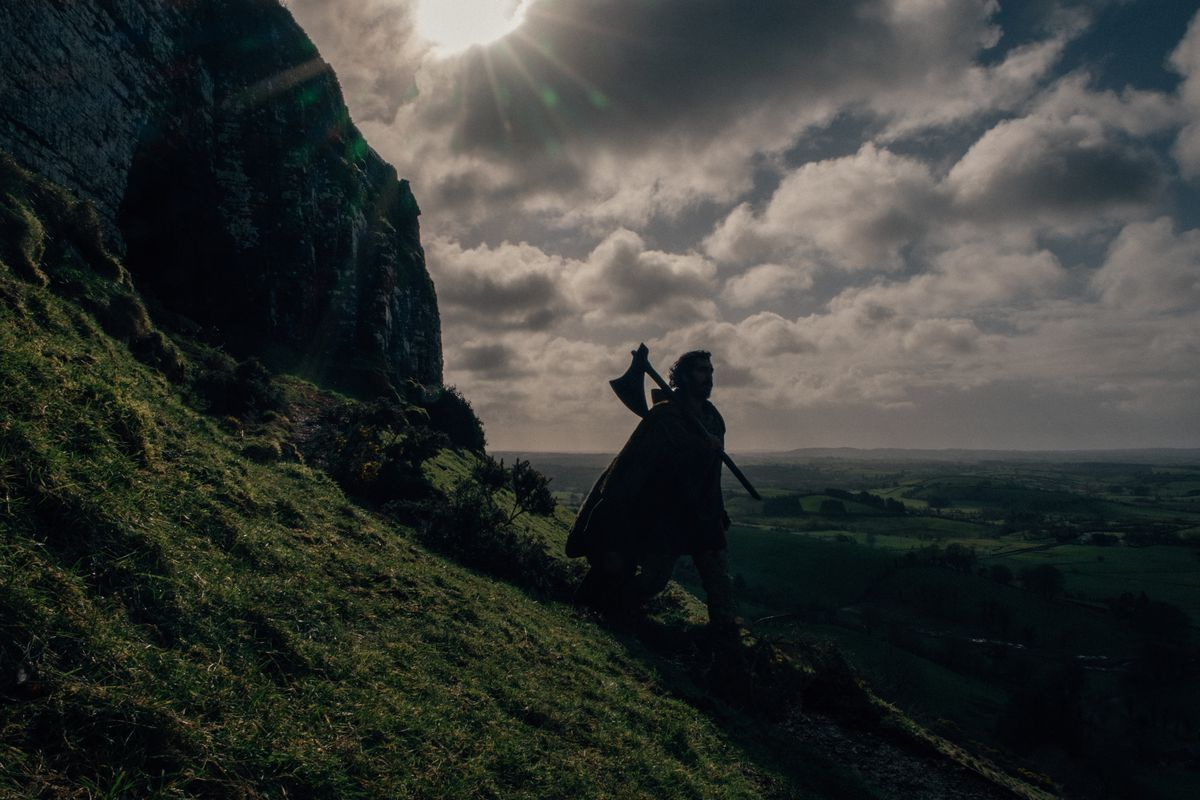 Gawain, silhouetted against the sky.