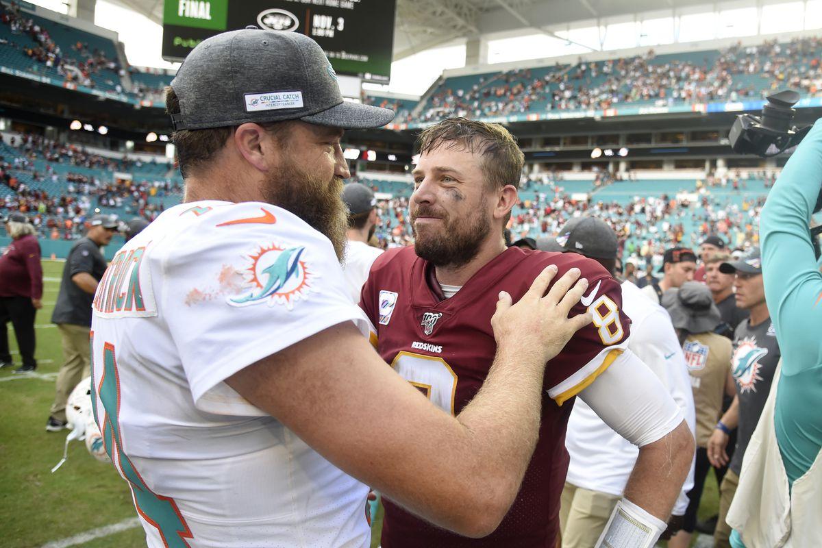 Miami Dolphins quarterback Ryan Fitzpatrick congratulates Washington quarterback Case Keenum after the game at Hard Rock Stadium on October 13, 2019 in Miami, Florida.