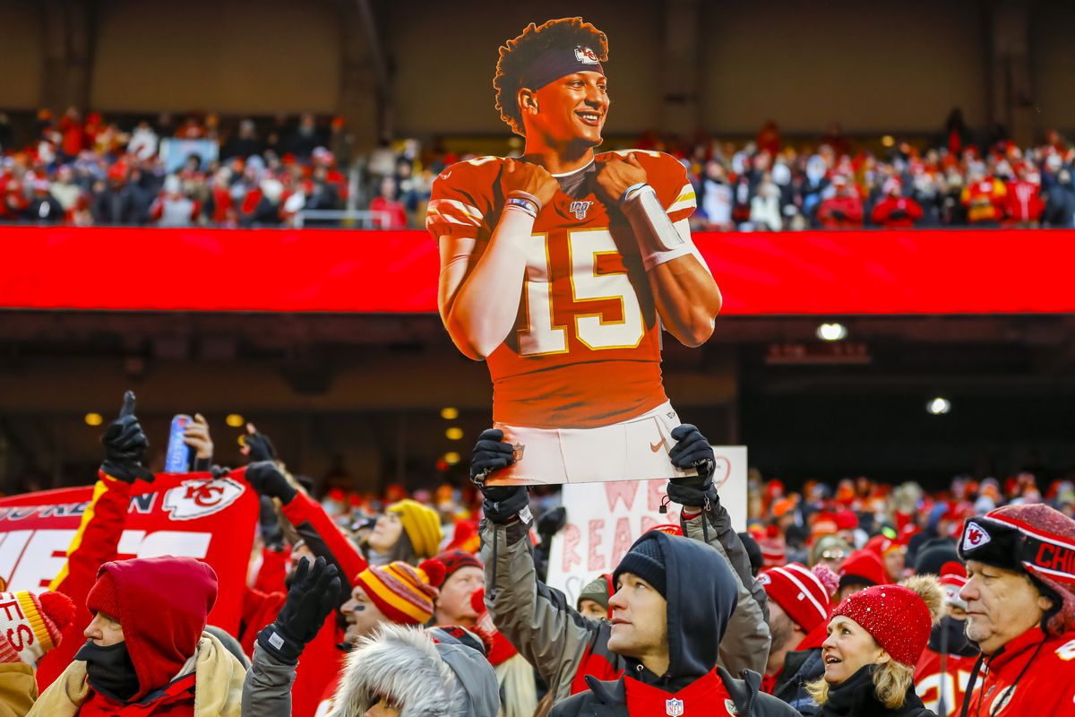 A Kansas City Chiefs fan holds up a poster photograph of Patrick Mahomes #15 of the Kansas City Chiefs during the fourth quarter of the AFC Championship game against the Tennessee Titans at Arrowhead Stadium on January 19, 2020 in Kansas City, Missouri.