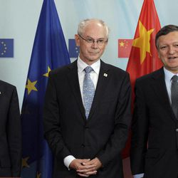Chinese Premier Wen Jiabao, left, stands alongside European Council President Herman Van Rompuy, center, and European Commission President Jose Manuel Barroso during an EU-China summit in Brussels on Thursday, Sept. 20, 2012.