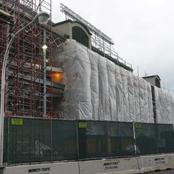 Tarps covering the Addison Street side of the ballpark, where the Draft Kings Sports Zone was located
