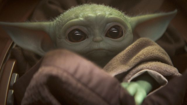 baby yoda sitting in his floaty crib on the mandalorian
