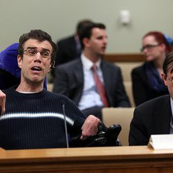 Public advocate Andrew Riggle of the Utah Disability Law Center speaks during a House Judiciary Committee meeting concerning HB101 at the Capitol in Salt Lake City on Wednesday, Feb. 3, 2016. HB101 is a bill that would eliminate the requirement that some wards be represented by an attorney in guardianship proceedings. At right is Rep. Fred Cox, R-West Valley City.