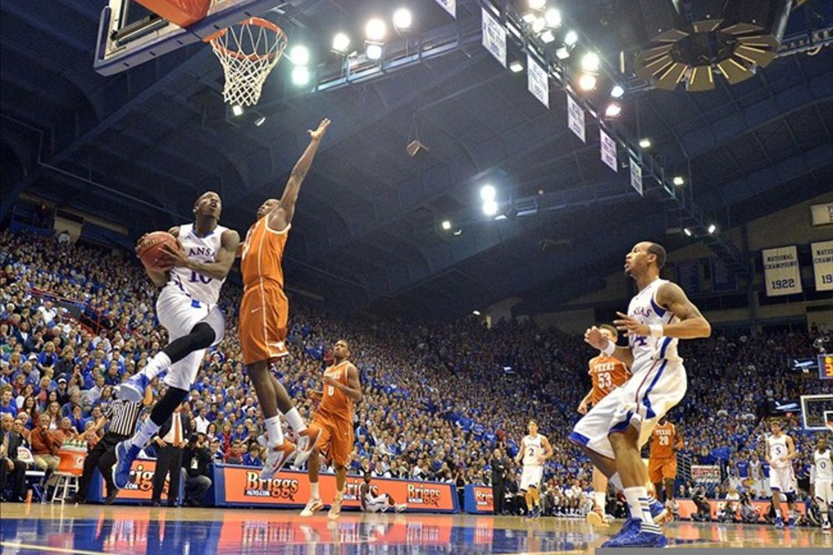 March 03, 2012; Lawrence, KS, USA; Kansas Jayhawks guard Tyshawn Taylor (10) shoots as Texas Longhorns guard J'Covan Brown (14) defends  in the first half at Allen Fieldhouse. Kansas won the game 73-63. Mandatory Credit: Denny Medley-US PRESSWIRE