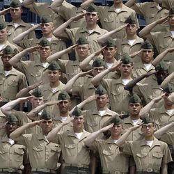 Marines salute during the national anthem before a baseball game between the San Diego Padres and the Los Angeles Dodgers Sunday, April 8, 2012, in San Diego.