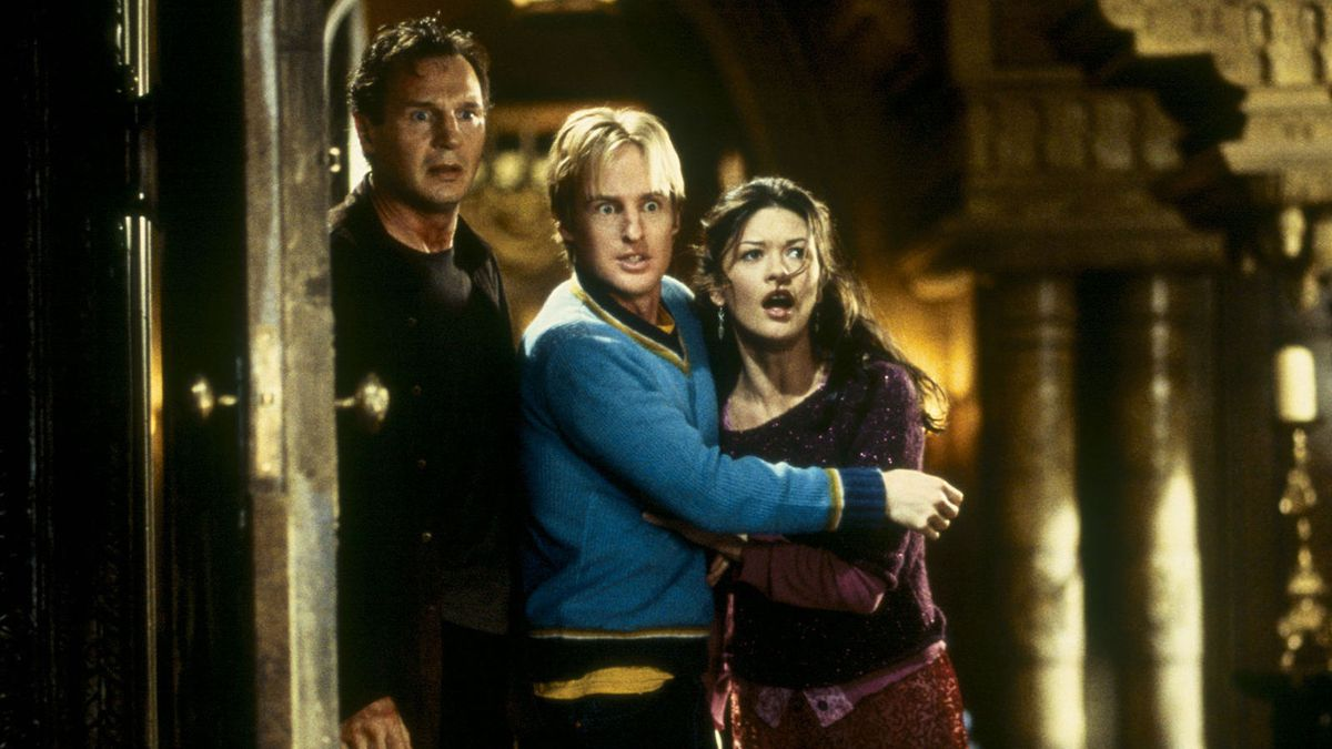 The Haunting cast: Liam Neeson, Owen Wilson, Catherine Zeta-Jones stand frightened in a haunted mansion doorway