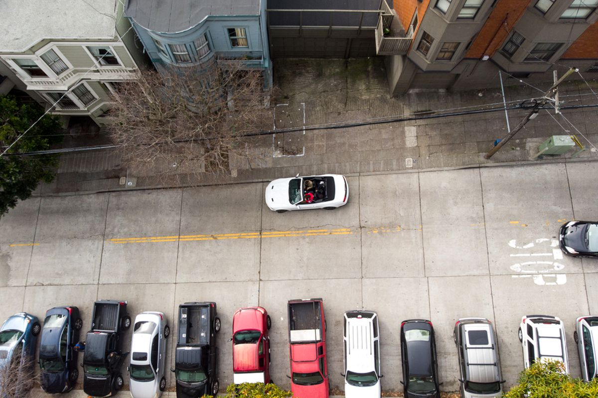 Cars parked in an SF alley, as seen from above.