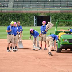 6:23 p.m. The grounds crew working the infield -