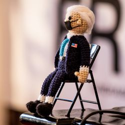 A tiny doll of President Joe Biden knitted by Vicky Chavez is displayed at the First Unitarian Church of Salt Lake City on Thursday, April 15, 2021.Chavez left the church, where she has spent more than three years living in sanctuary, on Thursday after receiving a one-year stay of removal.