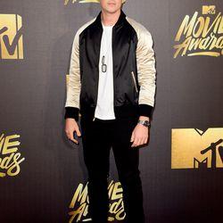 Miles Teller wears a silk bomber jacket.