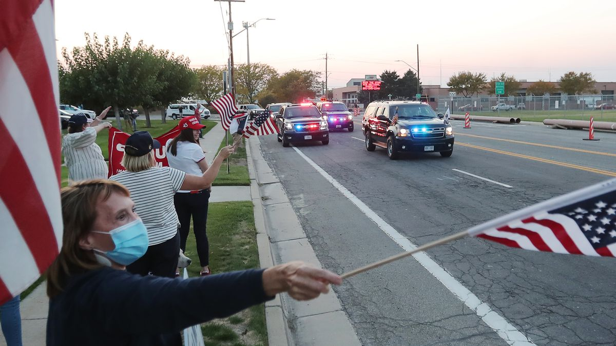 Supporters wave as Vice President Mike Pence's motorcade moves toward I-215 as he arrives in Salt Lake City on Monday, Oct. 5, 2020.