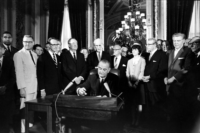 President Lyndon B. Johnson signs the Voting Rights Act of 1965.