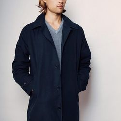 """American Trench's USA-made <a href=""""http://www.americantrench.com/shop/trench-coats/navy-trench-coat/"""">Dark Navy Trench</a> ($725) looks great with both business and weekend attire. Dress it up, dress it down, just don't get caught looking like a clown wi"""