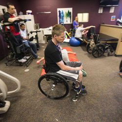 Dustin Shillcox, a paraplegic from Wyoming, shows how he is able to do his workout as he talks about a study that he is part of in Kentucky Monday, April 21, 2014. He is visiting at Neuroworx in South Jordan, where he has received therapy.