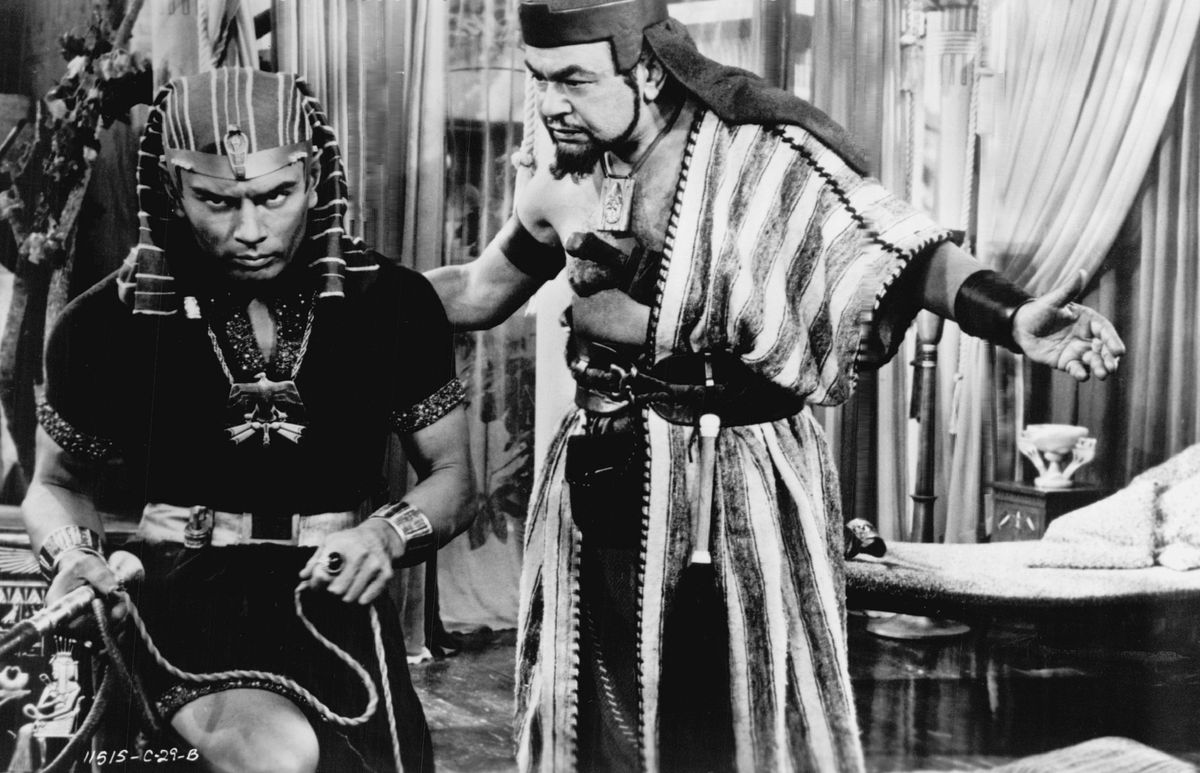 """Yul Brynner (as the Pharaoh) and Edward G. Robinson (as Dathan, the overlord) are shown in a scene from """"The Ten Commandments."""""""