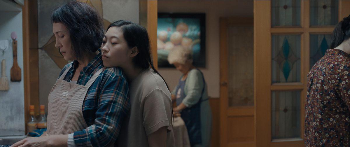 Jian (Diana Lin) and Billi (Awkwafina), with Little Nai Nai (Hong Lu) in background.
