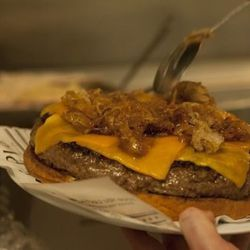 Carmelized onions go on top of the burger.