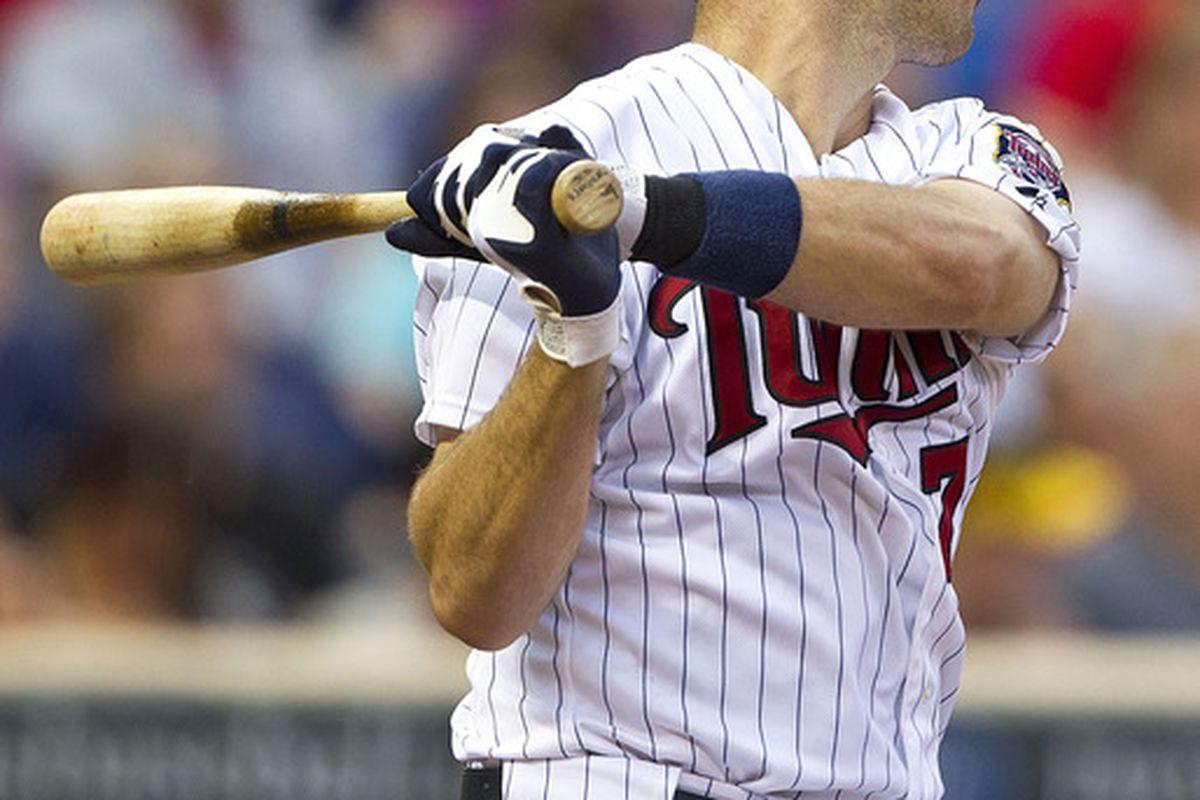 June 29, 2012; Minneapolis, MN, USA: Minnesota Twins catcher Joe Mauer (7) hits a single in the fourth inning against the Kansas City Royals at Target Field. Mandatory Credit: Jesse Johnson-US PRESSWIRE