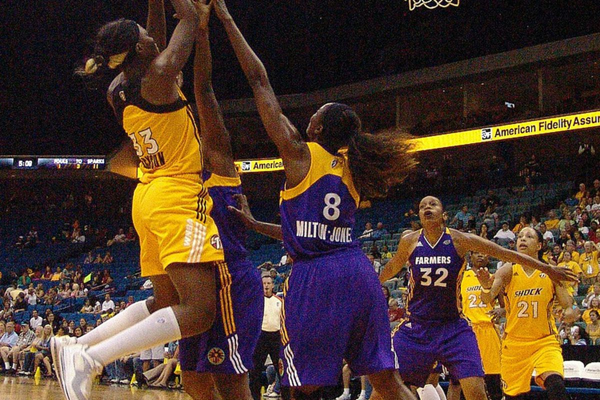 Tiffany Jackson skies over DeLisha Milton-Jones on her way to 14 points and 10 rebounds (photo by Troy Littledeer)