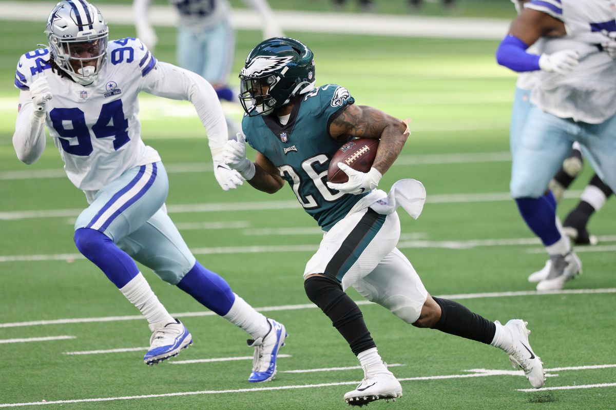 Miles Sanders #26 of the Philadelphia Eagles runs with the ball in the first half agaisnt Randy Gregory #94 of the Dallas Cowboys at AT&T Stadium on December 27, 2020 in Arlington, Texas.