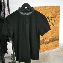 "A sleek contrast leather mandarin collar on a polo by <a href=""http://www.killcity.net/"">Kill City</a>."