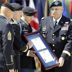 Sgt. Felipe Pereira, second from right, is awarded the Distinguished Service Cross by Army Chief of Staff Gen. Ray Odierno, right, and Maj. Gen. James C. McConville, commander of 101st Airborne, second from left, on Thursday, April 12, 2012, at Fort Campbell, Ky. Pereira suffered shrapnel wounds to his spleen, lung and liver when his unit was attacked in November 2010 in Kandahar province, but he refused medical treatment and helped to evacuate two other wounded soldiers.