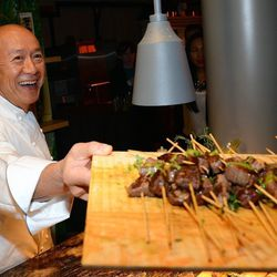 Chef Masayoshi Takayama serves Australian double black label beef skewers at the Tetsu booth at Vegas Uncork'd by Bon Appetit's Grand Tasting. Photo: Ethan Miller/Getty Images