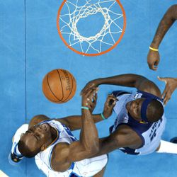 New Orleans Hornets forward Carl Landry, left, tries to shoot against Memphis Grizzlies forward Zach Randolph during the first half of an NBA basketball game in New Orleans, Sunday, April 15, 2012.